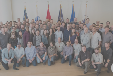 Tim Cook honors Veterans Day with a photo along with some of the veterans who work at Apple